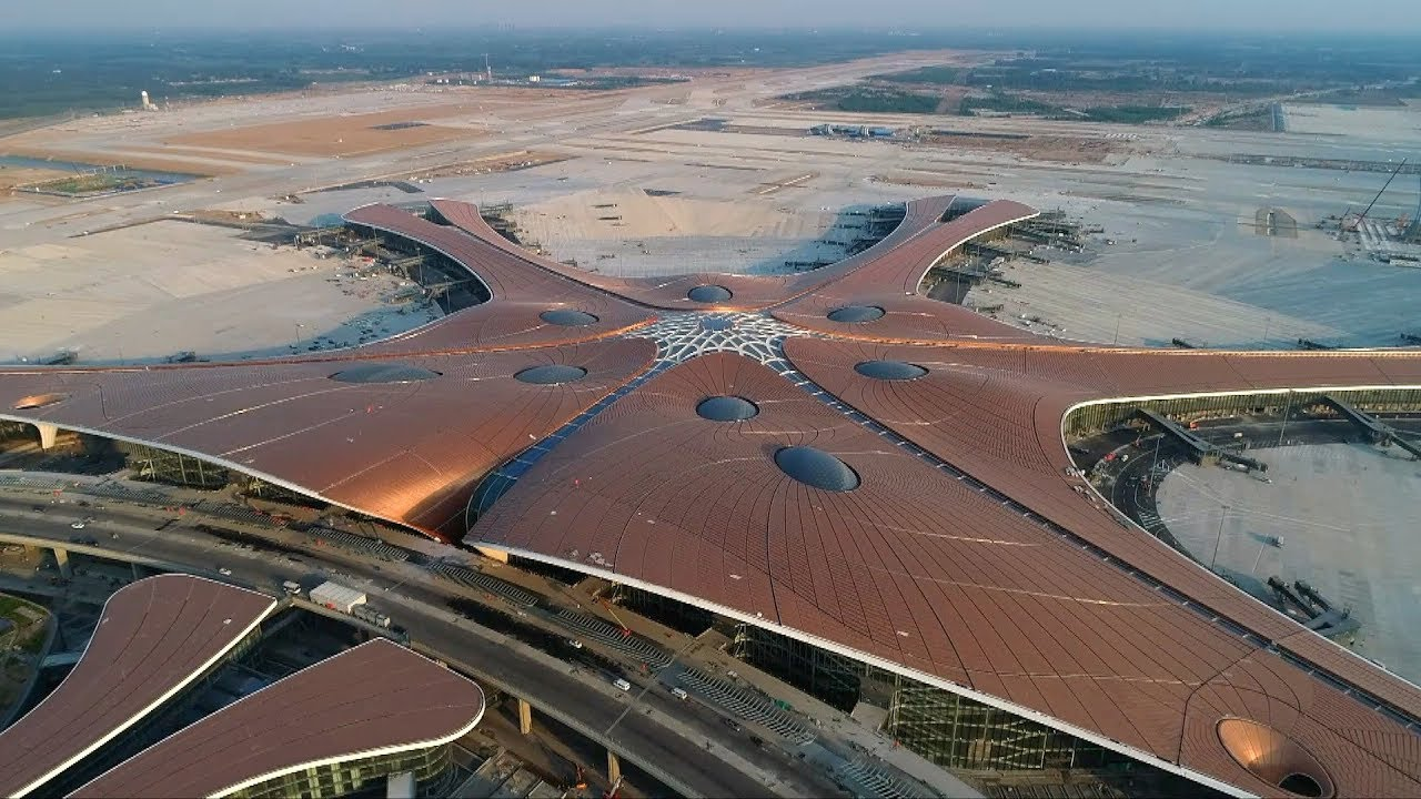 Beijing's new mega airport is nearing completion and is slated to open for business in September. The airport, set to be one of the world's largest aviation hubs, was designed by Zaha Hadid Architects to accommodate a whopping 120 million passengers a year.