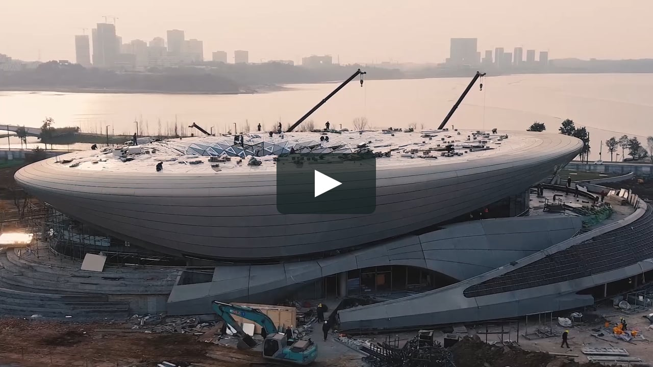 The Start-Up exhibition and conference centre, the first building within Chengdu's 67-hectare Unicorn Island masterplan in the Tianfu New Area, is nearing completion.